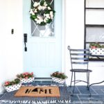 front door teal door front porch entryway